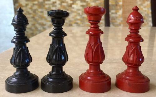 Early Victorian Gutta Percha Chessmen, red and black